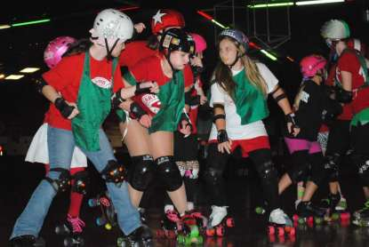 "Photo by Christina Kelso For the Times-Union Blockers (from left) Dahlia ""Cookie"" Cook, 13, Madison ""Wednesday At Emz'"" Wolfe, 15, and Braice ""Scrat"" Bays, 12 try to prevent the opposing team's jammer from breaking through their pack."
