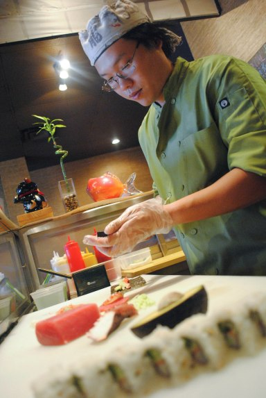 Chef Andy Himawan prepares sashimi in his Middleburg restaurant, Sushi Bistro. The small-town restaurant could see an upsurge in business as St. Vincent's Clay County Campus prepares to open across the street Oct. 1. (Christina Kelso/ The Florida Times-Union)