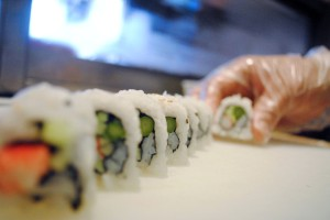 Sushi Chef Andy Himawan spreads out the pieces of a newly crafted California roll in his Middleburg restaurant, which opened in fall 2010. (Christina Kelso/ The Florida Times-Union)