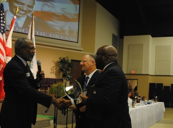 "MLK Day-N-Clay Founder and Organizer Pastor William H. Randall (From Left to Right) presents the ""Drum Major for Diversity Award"" to Pastor Michael Clifford and Pastor H.B Charles Jr., of Shiloh Metropolitan Baptist Church of Orange Park during the Fourth Annual Dr. Martin Luther King Jr. Diversity Breakfast, Monday Jan. 19."