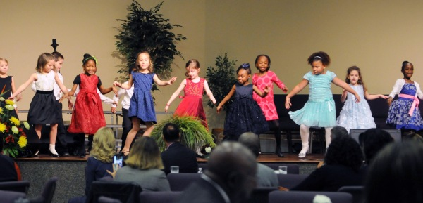 Children from Orange Park Performing Arts Academy's Kreative Kids After School Program dance to the 1930s popular music style that Martin Luther King Jr. would have heard as a child at the Fourth Annual Dr. Martin Luther King Jr. Diversity Breakfast, Monday Jan. 19.
