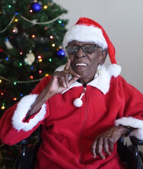 """Carrie Johnson, known as the """"Voice of Lincolnville,"""" is pictured in her home on Thursday, December 15, 2016. Johnson will lead Lincolnville's community Christmas caroling event for the 21st straight year."""