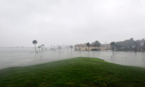 Storm surge from Hurricane Matthew spills over the Matanzas River seawall near the Castillo de San Marcos, flooding downtown on October 8, 2016. (Christina Kelso/ The St. Augustine Record)