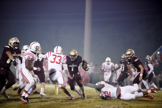 St. Augustine senior running back Jahquise Russell pushes moves past Crestview defensive players during a Class 6A regional semifinal game at SAHS on Friday, November 18, 2016. (Christina Kelso/ The St. Augustine Record)