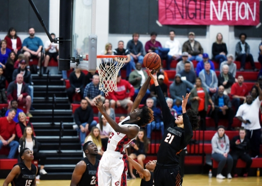 Creekside's Bobby Kasparzak attempts to dunk the ball in a home playoff game against Atlantic Coast on Thursday, February 16, 2017. (Christina Kelso/ The St. Augustine Record)