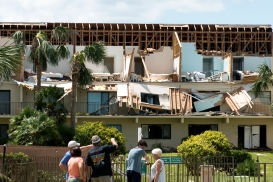 Residents of Summerhouse Beach and Racquet Club in Crescent Beach, gather at the center of the complex on Tuesday, September 12, 2017, to view damage caused by a tornado within Hurricane Irma.(Christina Kelso/ The St. Augustine Record)