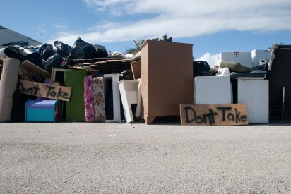 Possessions stacked in front of a Crescent Beach home on Wednesday October 12, 2016 as residents confront flood damage in the aftermath of Hurricane Matthew. (Christina Kelso/ The St. Augustine Record)