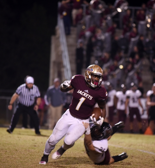 St. Augustine running back Jahq Russell pushes past Navarre linebacker Xavier Fernandez during a Region 1-61 final on Friday, November 25, 2016 at St. Augustine. (Christina Kelso/ The St. Augustine Record)