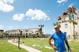 Jon Davis, night manager of Summerhouse Beach and Racquet Club in Crescent Beach, surveys damage throughout the community on Tuesday, September 12, 2017, the day after a tornado within Hurricane Irma ripped entire walls and ceilings from multiple condominiums in the complex. Davis heard the winds striking as weathered the storm from inside his own condominium, which evaded damage. (Christina Kelso/ The St. Augustine Record)