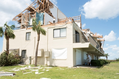 A man sweeps the front porch of his home in Summerhouse Beach and Racquet Club in Crescent Beach on Tuesday, September 12, 2017, the day after a tornado within Hurricane Irma ripped the roof and second story walls from it. (Christina Kelso/ The St. Augustine Record)