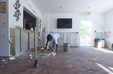 Don White, maintenance worker for Grafton House assisted living facility on Marine Street, removes flood damaged drywall from the building's interior on Wednesday October 19, 2016. With little of the ground floor salvageable and an estimated four to six months of repairs ahead, the Grafton House's 16 residents have had to find new homes in the wake of Hurricane Matthew. (Christina Kelso/ The St. Augustine Record)