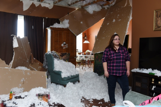 Insulation from a caved in ceiling fills the living room of Elizabeth Hevia's Heritage Landing home on Wednesday, February 8, 2017. At approximately 10:30 p.m. on Tuesday, a tornado struck the home with Hevica as well as her mother, children and pets inside, rendering it uninhabitable. (Christina Kelso/ The St. Augustine Record)