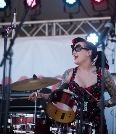 Katie Gay, drummer for St. Augustine rockabilly trio Go Get Gone, plays with the band for the Rhythm and Ribs festival at Francis Field on Saturday, April 1, 2017. With all profits going to charity, the 22nd annual festival brings together seven award-winning regional and national barbecue restaurants and hosts daylong live music, festival games and activities. Rhythm and Ribs continues today from 11 a.m. to 6 p.m. (Christina Kelso/ The St. Augustine Record)
