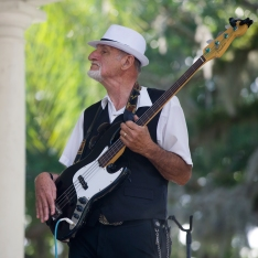 Luis Mario Peral and His Rumba Kings bassist Tony McLeod, plays with the band at the Plaza de la Constitucion on Friday, May 5, 2017 in a free Cinco de Mayo concert kicking off the first night of St. Augustine's Romanza Festivale of the Arts. The festival continues through May 14, and includes a series of music, dance, art and cultural events throughout the city. (Christina Kelso/ The St. Augustine Record)