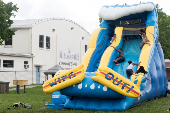 Children play on an inflatable waterslide during #TeamHastings' fourth annual Community Come Together Day at the W. E. Harris Community Center in downtown Hastings on Saturday, June 10, 2017. #TeamHastings, a community volunteer group comprised of six local men, invited Hastings residents to a day of free food, music and recreation as a way to not only give back to the community, but to help to foster healthy relationships within it. The event was hosted with the assistance of local churches and business as well as St. Johns County Parks and Recreation and the St. Johns County Library. (Christina Kelso/ The St. Augustine Record)