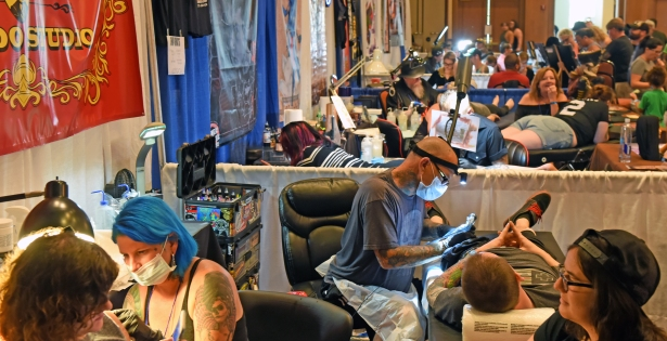 The mechanical hum tattoo needles echoes throughout the St. Johns County Convention Center at World Golf Village on Saturday, August 26, 2017 as artists from across the country work and compete in the second day of the 2017 Jacksonville Tattoo Convention. (Christina Kelso/ The St. Augustine Record)