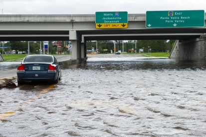 An abandoned car sits in the flooded intersection of Interstate-95 and County Road 210 on Monday, September 11, 2017, the morning after Hurricane Irma impacted the area. (Christina Kelso/ The St. Augustine Record)