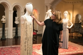 """Nancy Lawson, costume specialist and co-curator of """"Dressing Downton: Changing Fashions for Changing Times,"""" discusses the details of an original gown worn by character Freda Dudley Ward in season four of """"Downton Abbey"""" during a media preview of the long-awaited exhibition in the Grand Ballroom Gallery of the Lightner Museum on October 3, 2017. The exhibition features 36 original costume pieces from the show, displayed alongside intricately crafted furnishings and art from Otto Lightner's original collection of the same time period. The exhibit opens today, October 4, 2017 and runs through January 7, 2018. (Christina Kelso/ The St. Augustine Record)"""