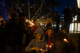 Children light candles in the Plaza de la Constitucion on Wednesday, December 13, 2017, at Chabad of St. Augustine's 11th annual public Hanukkah celebration on Wednesday, December 13, 2017, the second day of Hanukkah. (Christina Kelso/ The St. Augustine Record)