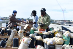 Fireworks by Santore pyrotechnic crew members Marcos Ickes, from left, Christopher Washington, and King Sowm set up fireworks on the St. Johns County Ocean Pier on Friday, December 30, 2016 in preparation for Saturday's New Year's Eve Beach Blast Off fireworks display. The free event takes place tonight from 4 p.m. to 11 p.m. at St. Johns County Ocean Pier Park and includes live entertainment, food vendors, a kids zone, and a fireworks display synchronized to music from 8:30 p.m. to 9:00 p.m. (Christina Kelso/ The St. Augustine Record)