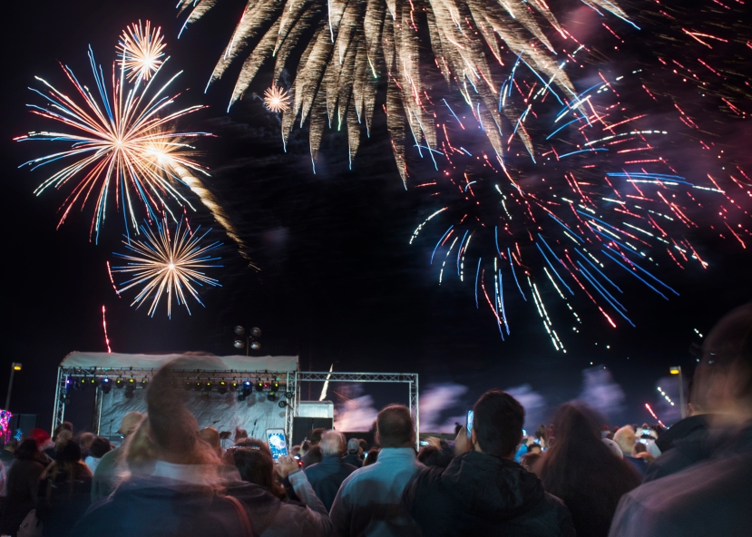 (Christina Kelso/ The St. Augustine Record) Fireworks burst over Pier Park in St. Augustine Beach as hundreds of people gather to celebrate New Year's Eve at Beach Blast Off on Sunday, December 31, 2017.