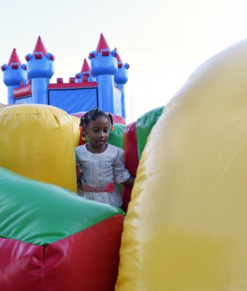 Five-year-old Jaishiya Pretty makes her way through the bounce course at 37th annual Lincolnville Festival on Saturday September 24, 2016. (Christina Kelso/ The St. Augustine Record)